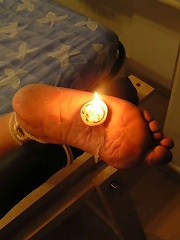 Woman gets hot candle wax on her bare foot