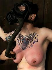 Big Titty Sybian Riding Slut wears Gas Mask