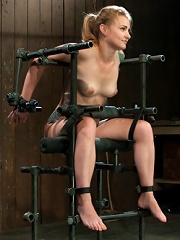 Bound in a custom metal bondage rig. Made to cum, she cant stop the orgasms that rip though her